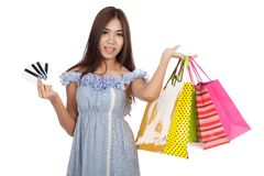 Beautiful Asian woman hold shopping bags show 4 credit cards Royalty Free Stock Images