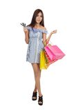 Beautiful Asian woman hold shopping bags show credit cards Stock Photo