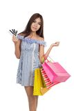 Beautiful Asian woman hold shopping bags show credit cards Royalty Free Stock Photo