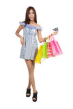 Beautiful Asian woman hold shopping bags show credit cards Stock Image