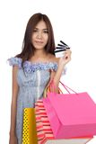Beautiful Asian woman hold shopping bags show credit cards Stock Images
