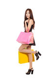 Beautiful Asian woman hold shopping bags walikng Royalty Free Stock Images