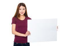 Beautiful asian woman holding a blank whiteboard Royalty Free Stock Images