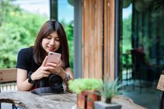 Beautiful Asian Woman holding Camera in the Garden royalty free stock images