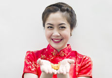 Beautiful asian woman holding chinese gold in Royalty Free Stock Photo