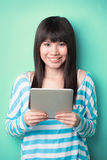 Beautiful Asian woman holding a Digital Tablet Stock Images
