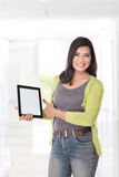 Beautiful asian woman holding a digital touch screen tablet comp Royalty Free Stock Photos