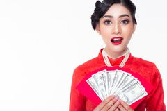 Beautiful asian woman holding dollars or money and red envelopes. Attractive beautiful woman get happiness when gorgeous girl stock photography