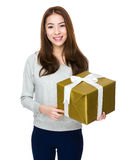 Beautiful asian woman holding a gift box Stock Photography
