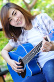 Beautiful asian woman holding Guitar Stock Images