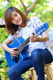 Beautiful asian woman holding Guitar Royalty Free Stock Photo