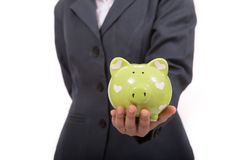 Beautiful asian woman holding piggy bank Royalty Free Stock Photos