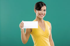 Holding  a white paper card Royalty Free Stock Image