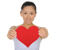 Beautiful Asian woman holds out the heart Stock Image