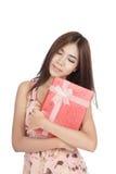 Beautiful Asian woman hug red gift box Stock Photo