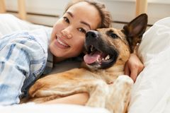 Beautiful Asian Woman Hugging Dog royalty free stock photography