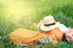 beautiful asian woman lay on grass stock images