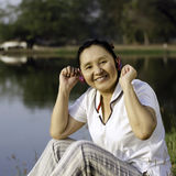 Beautiful asian woman listening music in headphones Royalty Free Stock Photo