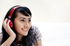 Beautiful Asian woman listening to music Stock Photography