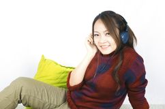 Beautiful asian woman listening to music. Listening Music Headphones Concept. stock photos