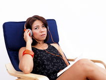 Beautiful Asian woman listens to music Stock Photos