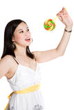 Beautiful asian woman and lollipop Royalty Free Stock Image