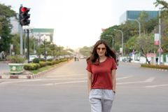 Beautiful Asian woman with long hair wearing sunglasses walking on street stock photos