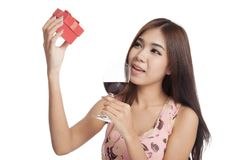 Beautiful Asian woman look at  gift box hold red wine Stock Photo