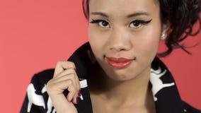 Beautiful Asian Woman Looking At Camera In Studio. stock video