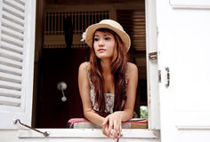 Beautiful asian woman looking out of the window Royalty Free Stock Photography