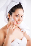Beautiful asian woman with lotion Royalty Free Stock Images