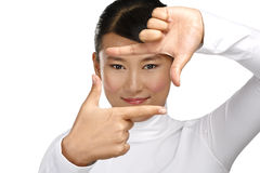 Beautiful asian woman make a frame shot symbol with her hands Stock Photos