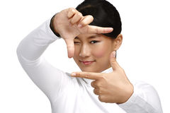 Beautiful asian woman make a frame shot symbol with her hands Stock Photography