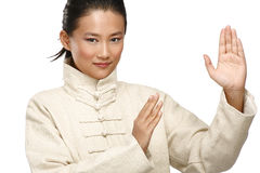 Beautiful asian woman make kung fu gesture Stock Photo