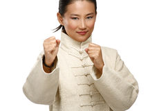 Beautiful asian woman make kung fu gesture Royalty Free Stock Photos
