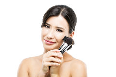 Beautiful Asian woman with make-up brushes Royalty Free Stock Image
