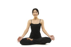 A beautiful Asian woman meditating Stock Photos