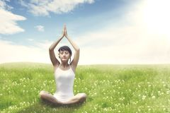 Sweet Asian Woman meditating outdoor Royalty Free Stock Image