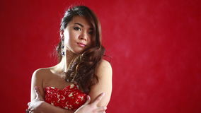 Beautiful asian woman model portrait in hot red dress. Chinese Asian female fashion model brunette stock footage