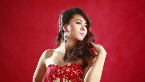 Beautiful asian woman model portrait in hot red dress. Chinese Asian female fashion model brunette stock video footage