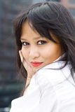 Beautiful Asian Woman in Modern Setting. Wearing a white collared shirt Stock Image