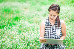 Beautiful asian woman with notebook in park Royalty Free Stock Photos