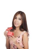 Beautiful Asian woman open a  red gift box Royalty Free Stock Photography