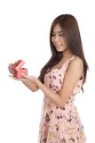 Beautiful Asian woman open a  red gift box Royalty Free Stock Image
