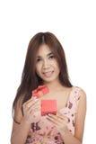 Beautiful Asian woman open a  red gift box Stock Photo