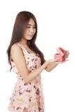 Beautiful Asian woman open a  red gift box Stock Photos