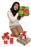 Beautiful Asian woman opening Christmas presents stock photo