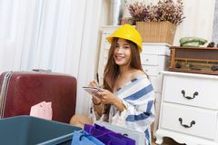 Beautiful woman packing object move new home. royalty free stock image