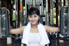 Beautiful Asian Woman on a Pet Deck Machine Royalty Free Stock Photography
