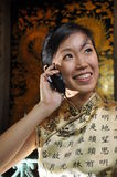 Beautiful Asian Woman On The Phone Royalty Free Stock Image